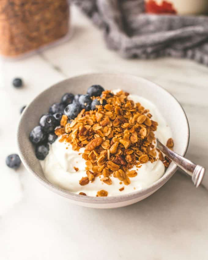 slow cooker granola topping yogurt with blueberries in a bowl