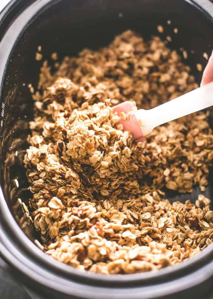 stirring granola in the slow cooker