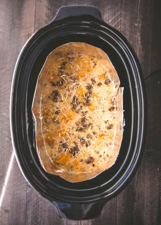 uncooked breakfast casserole in a slow cooker