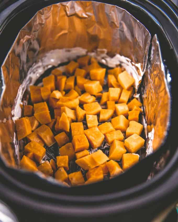 cut sweet potatoes in the slow cooker
