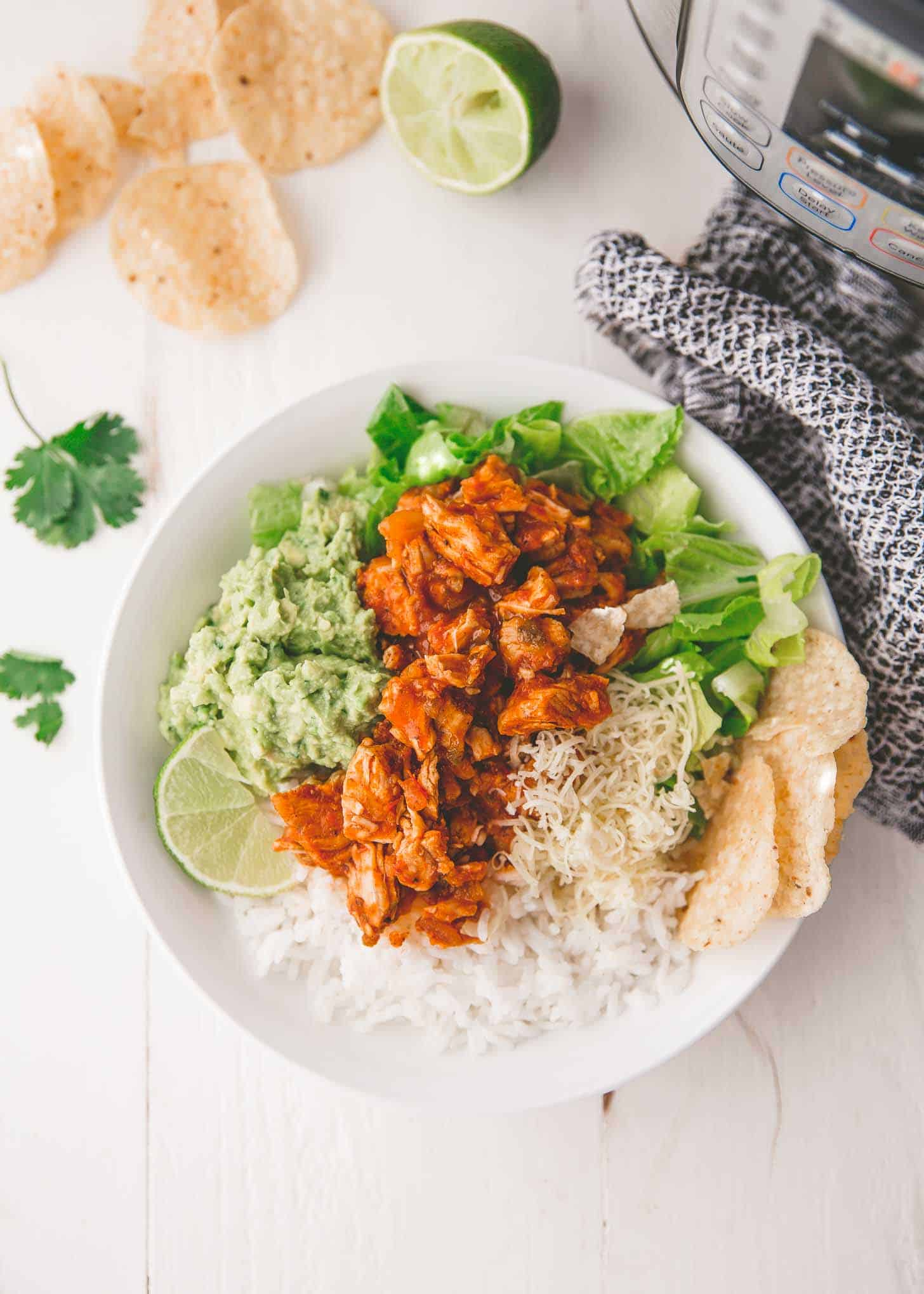 chicken burrito bowls on a white table