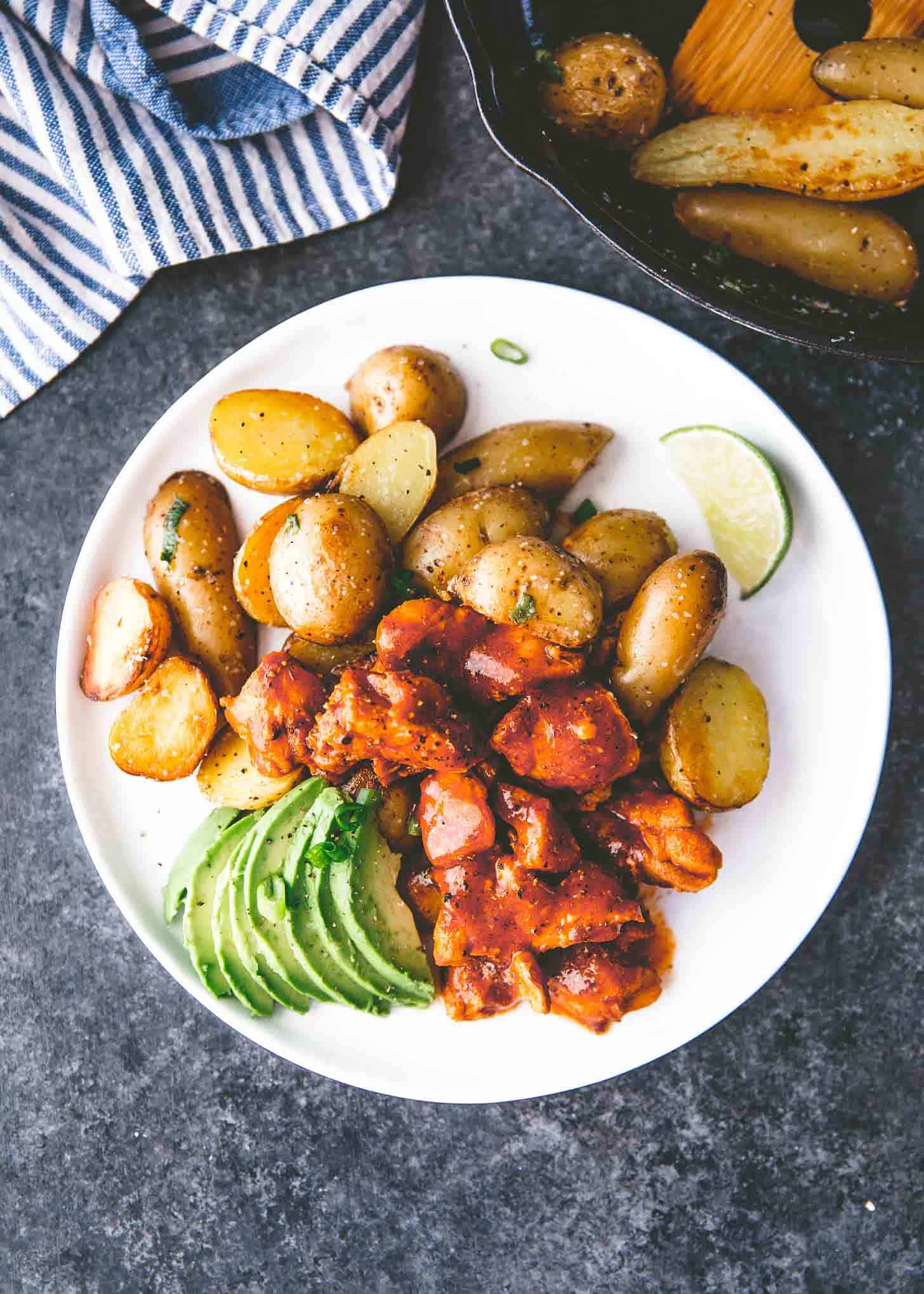 honey adobo chicken and potatoes on a white plate