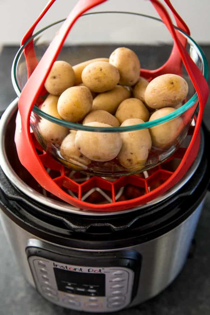 placing potatoes in an instant pot