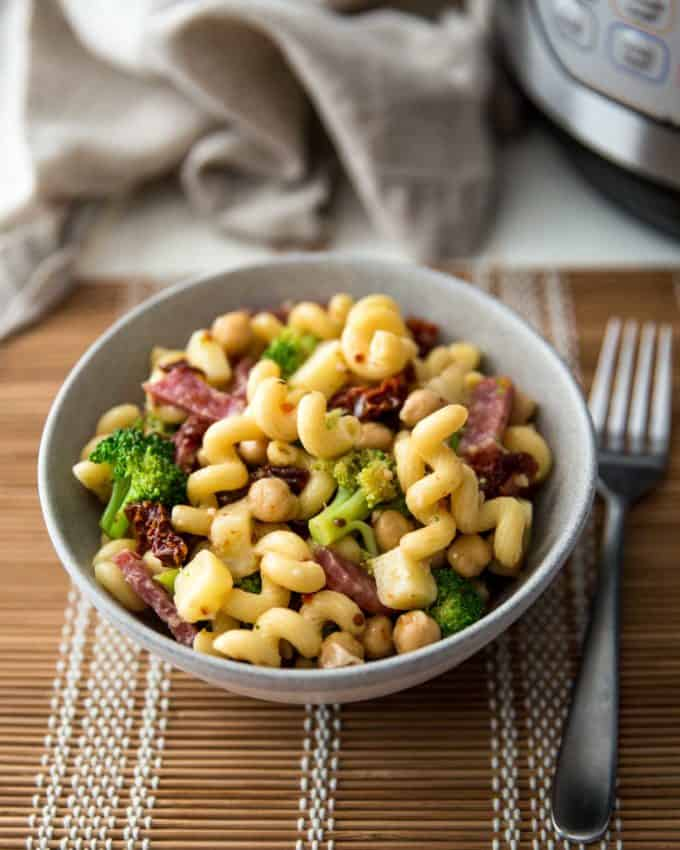 italian pasta salad in a grey bowl on a table