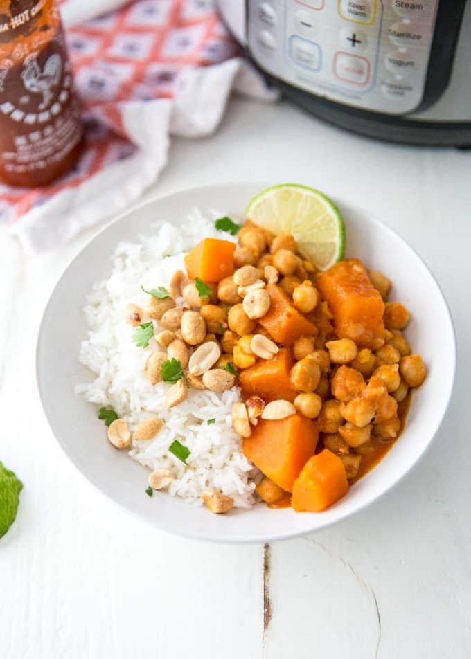 thai panang curry over rice in a white bowl