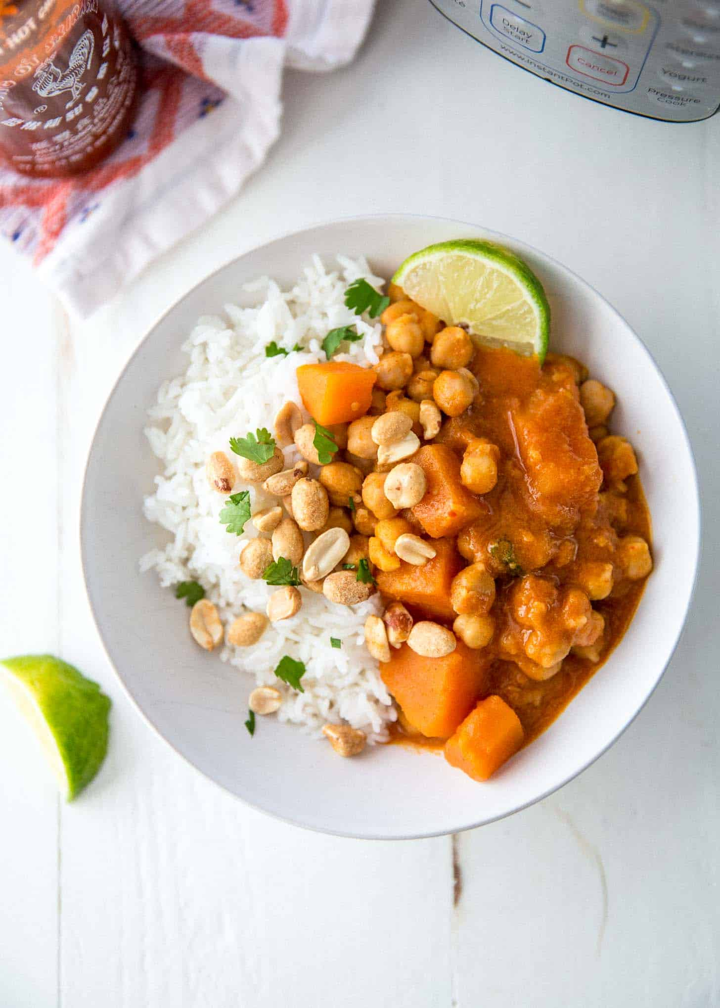 thai panang curry over rice on a white plate