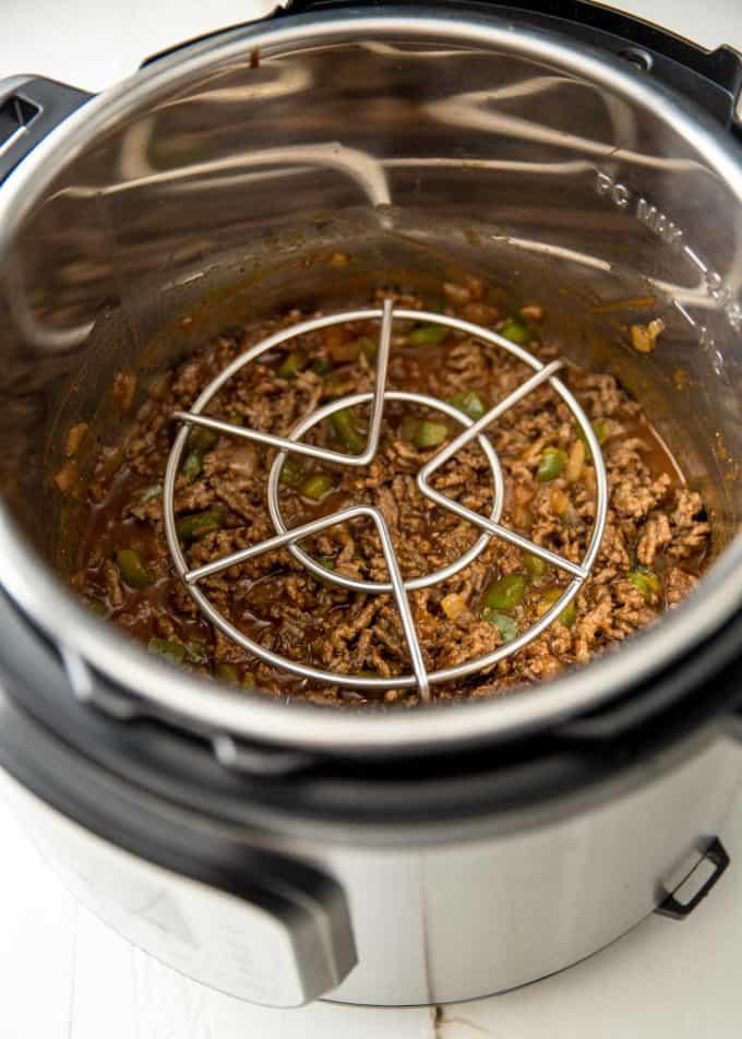sloppy joe mixture in an instant pot with a metal trivet