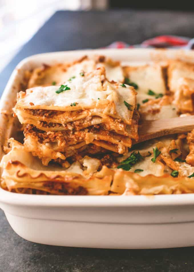 lasagna bolognese in a white ceramic baking dish
