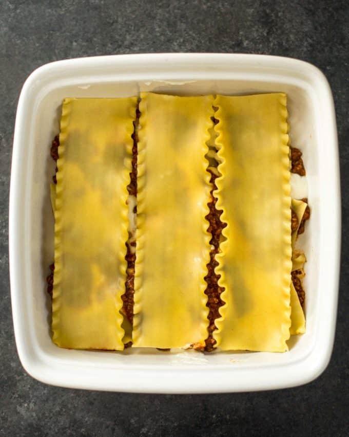 layering ingredients for lasagna
