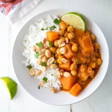 Vegetarian Thai Panang Curry over rice in a white bowl