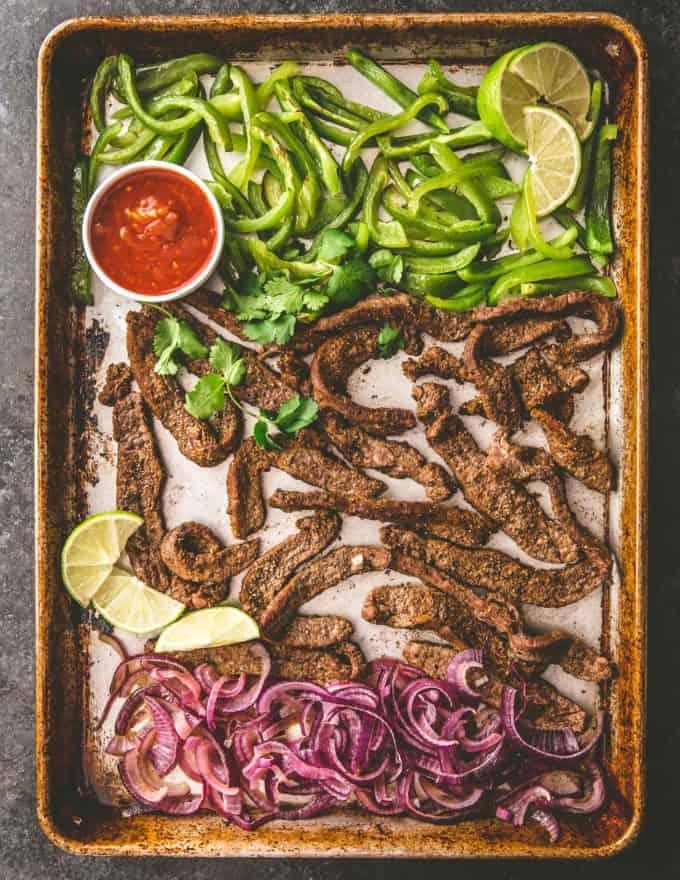 steak fajitas and peppers on a sheet pan