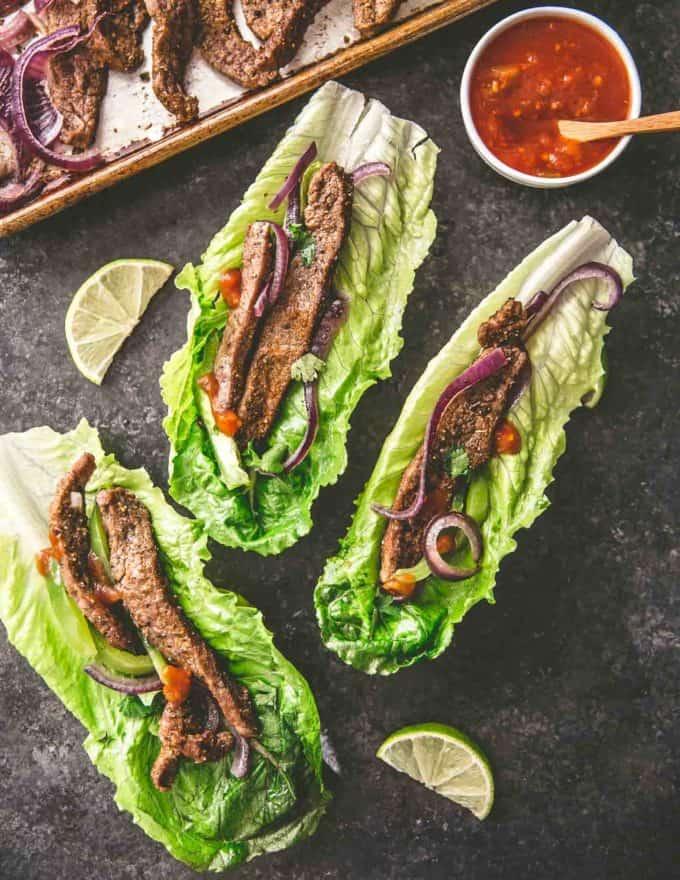 sheet pan steak fajitas on lettuce cups with salsa