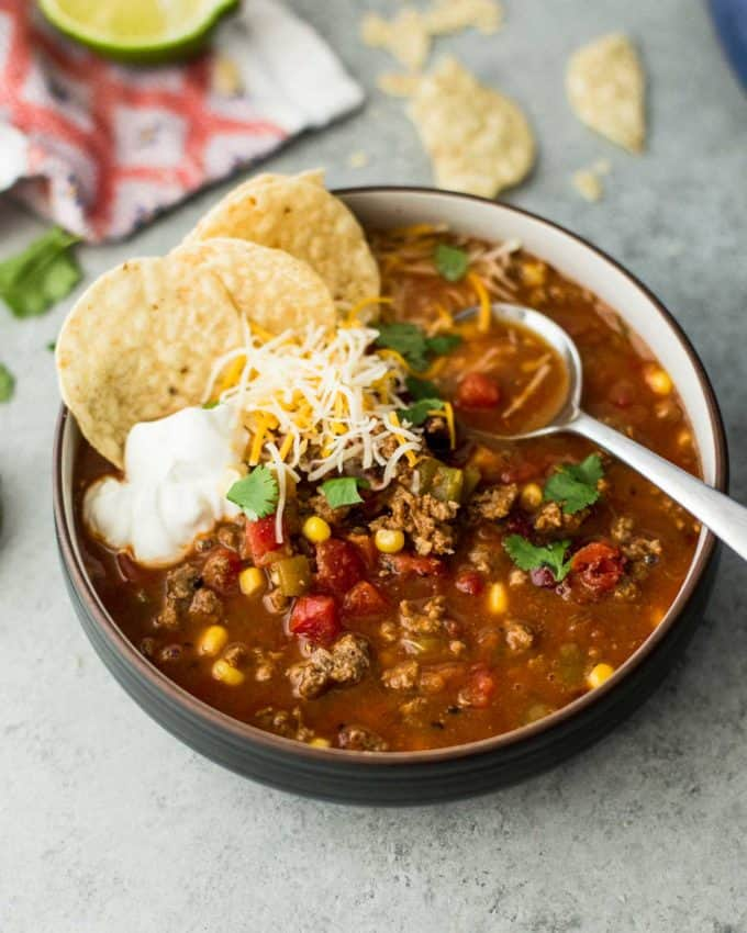 a bowl of taco soup with a spoon