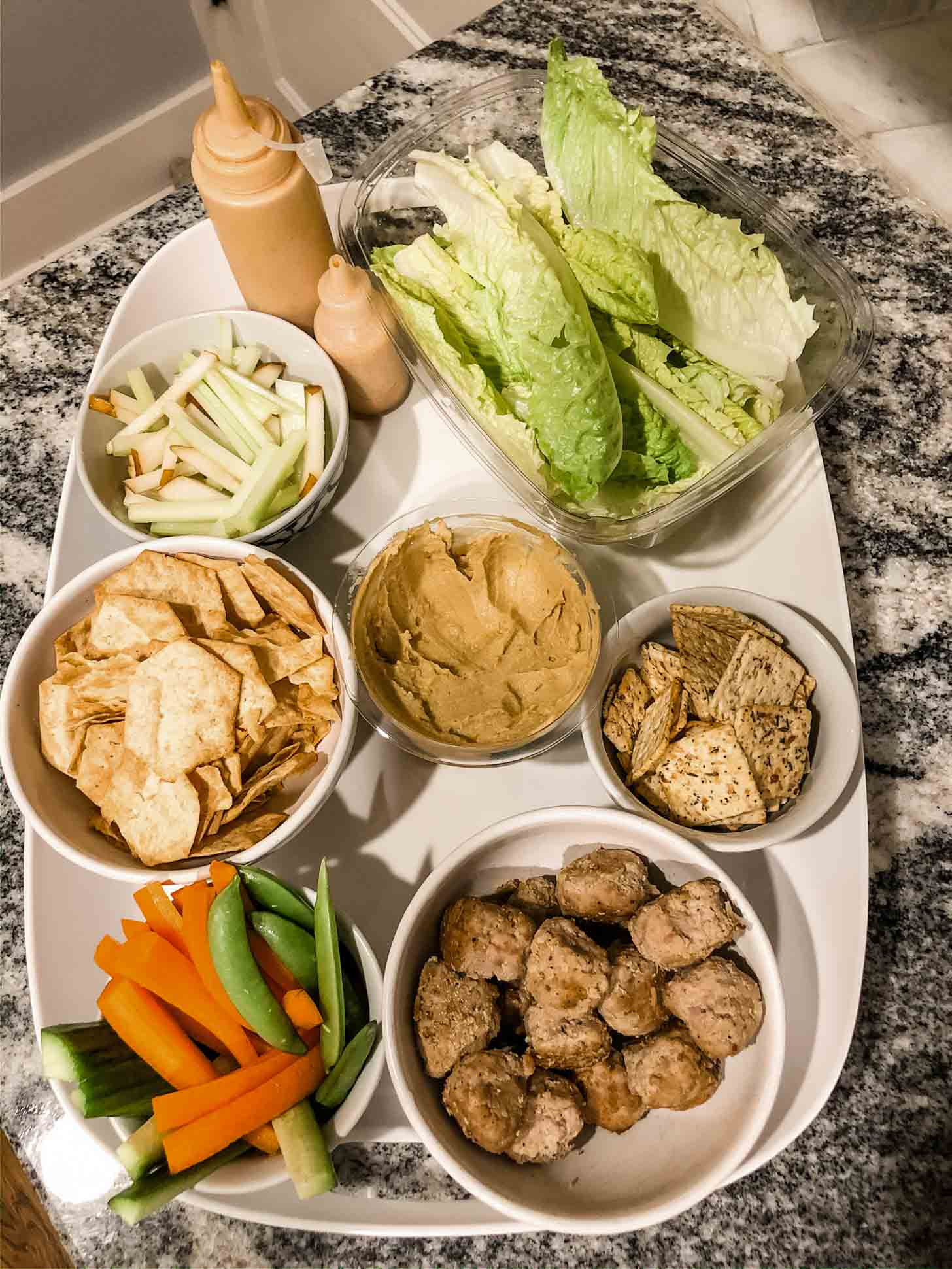 ingredients for turkey meatball lettuce cups on a white tray