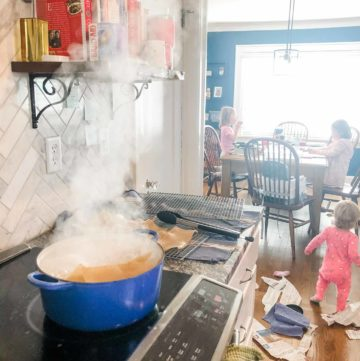 cooking pasta in a blue dutch oven