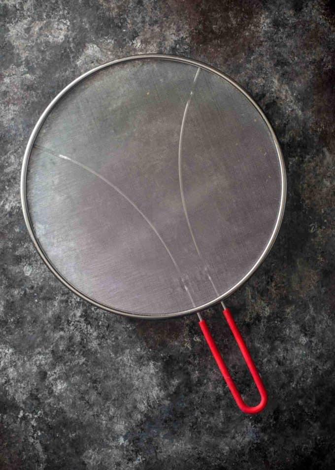 splatter screen on a grey countertop