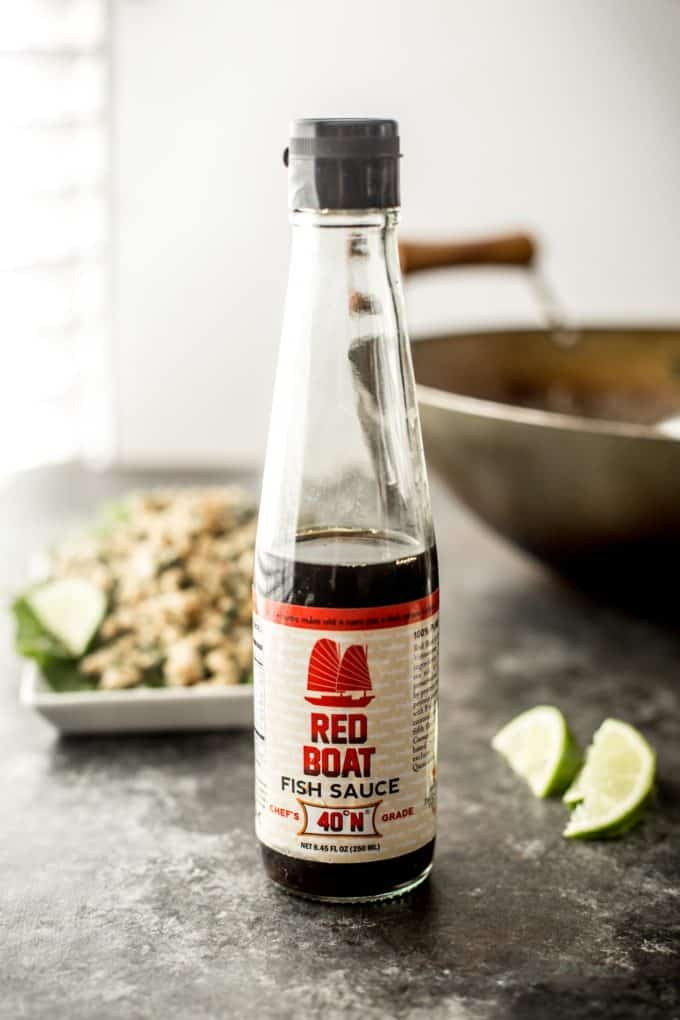 a bottle of fish sauce on a countertop