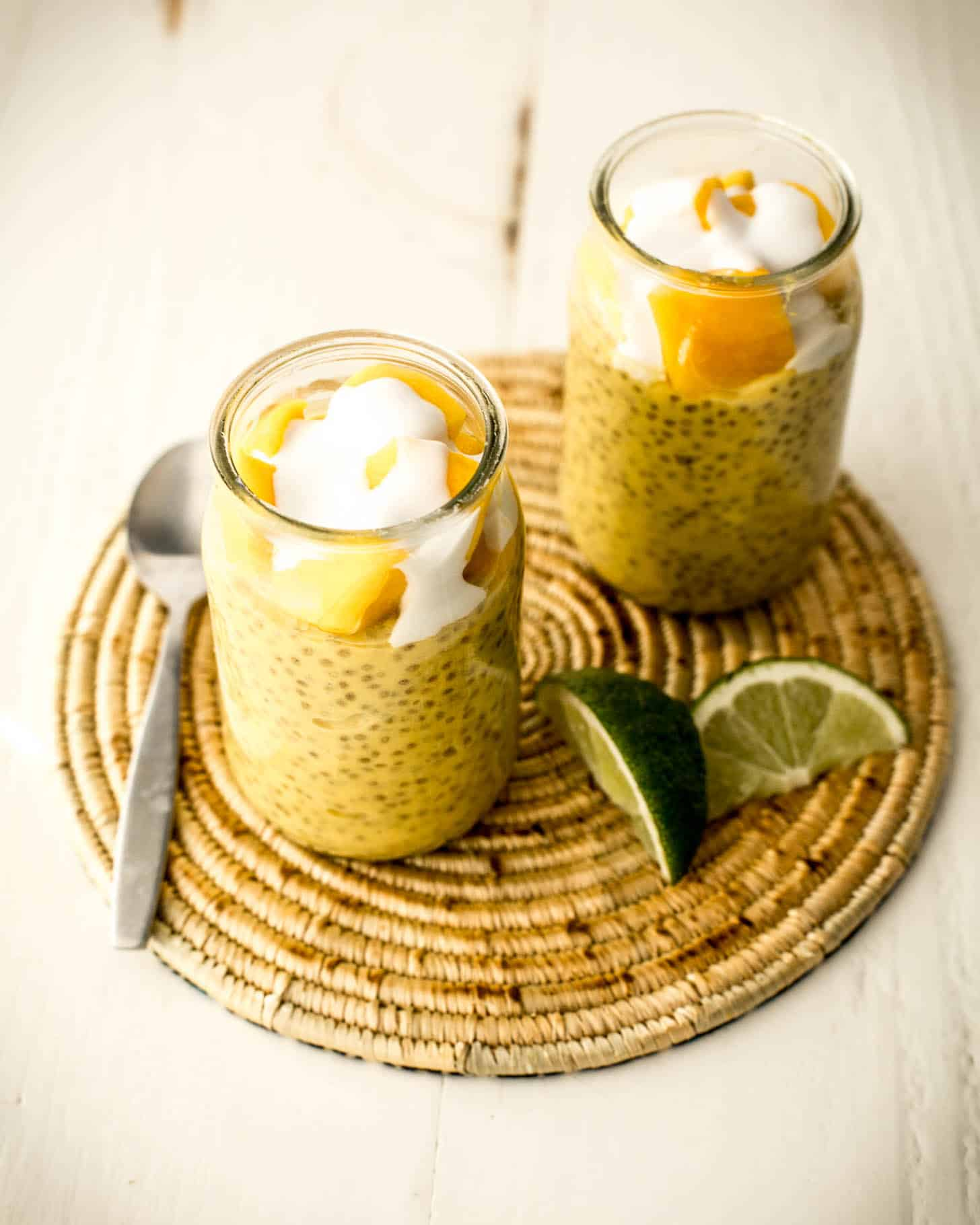 mango chia seed pudding in two glass jars