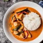 Thai Red Curry in a white bowl over rice