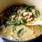 thai green curry in a blue dutch oven