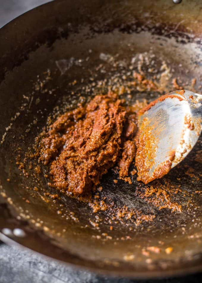 making massaman curry paste in a wok