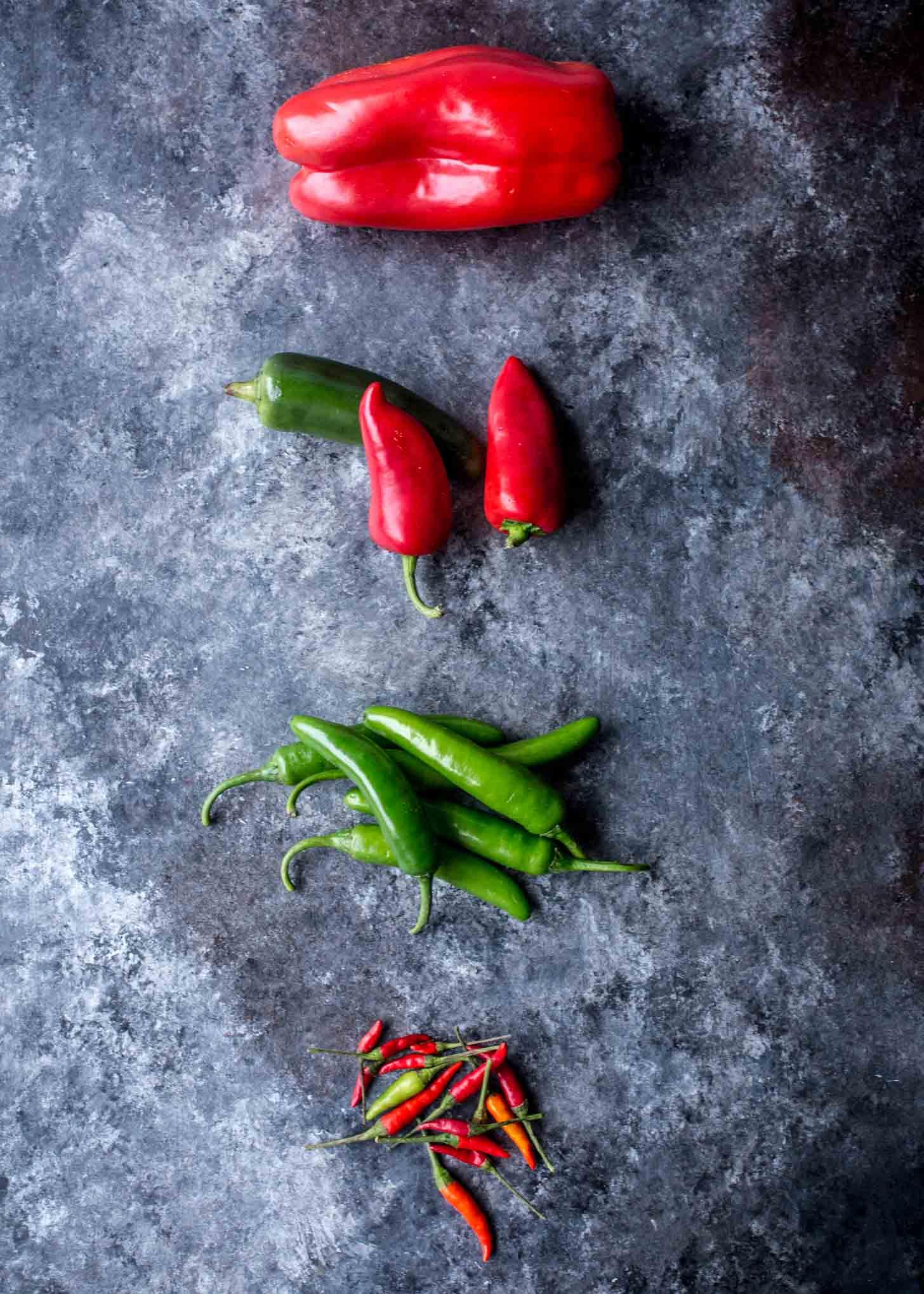 fresh chilis on a grey countertop