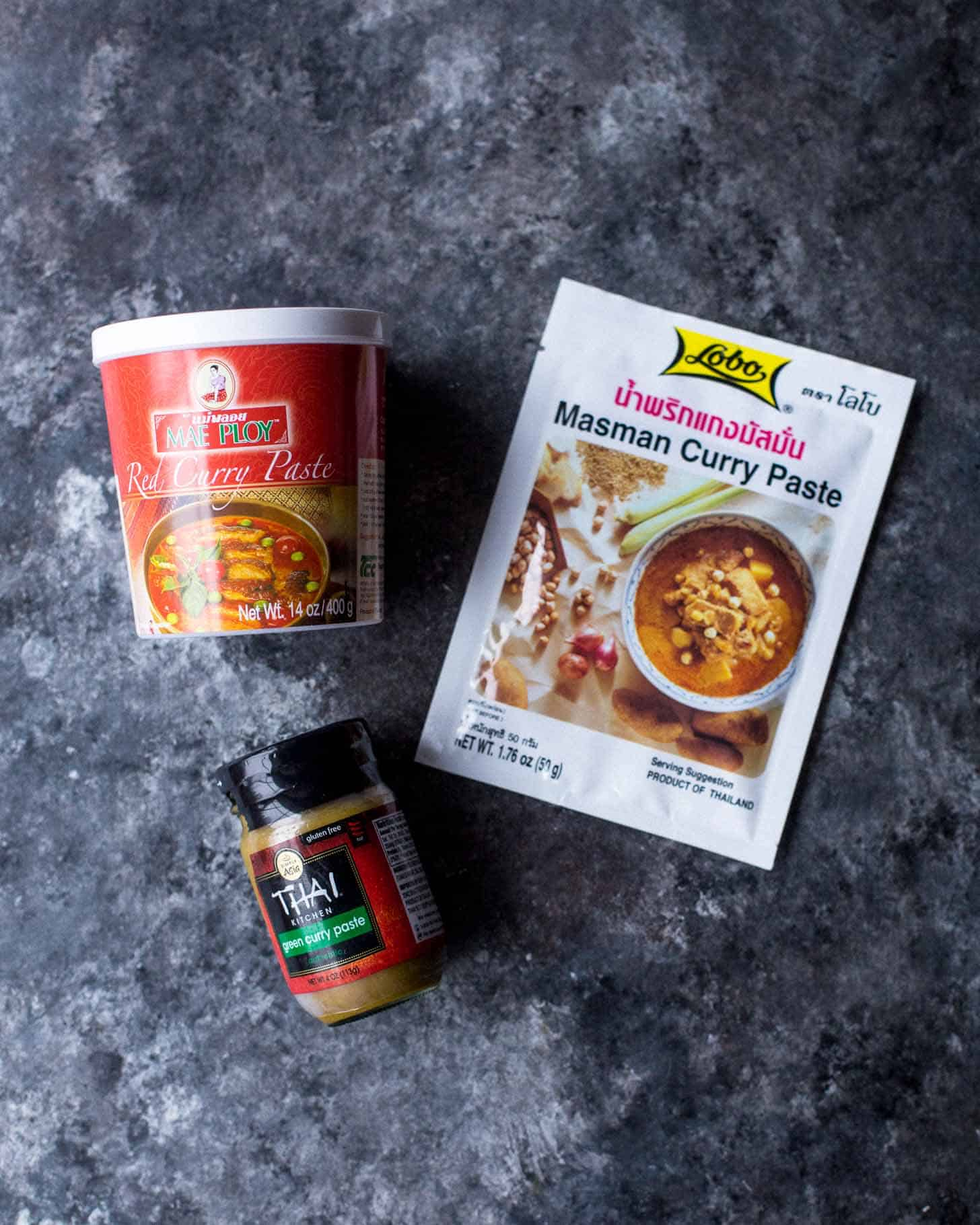 different types of curry paste on a grey countertop