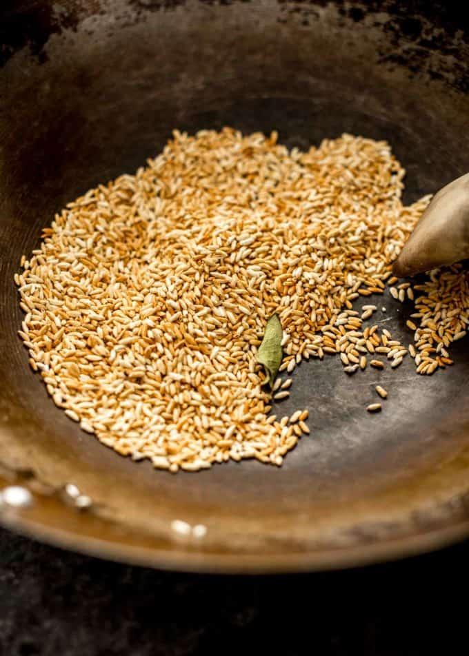 toast rice in wok