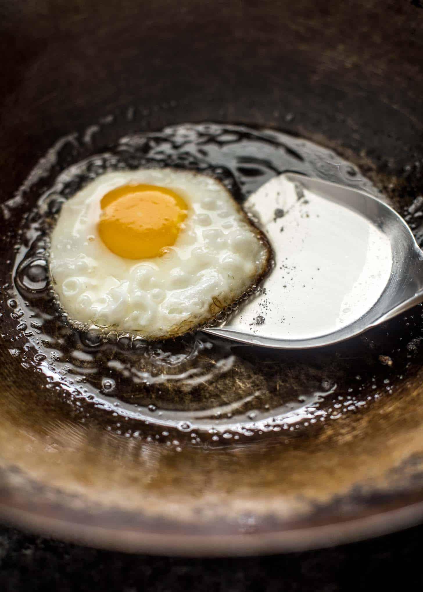 frying an egg in a wok
