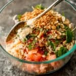 stirring thai pomelo salad
