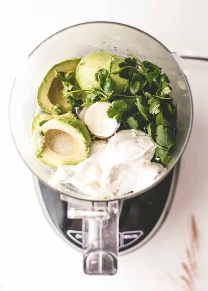 avocado, cilantro, and sour cream in a food processor