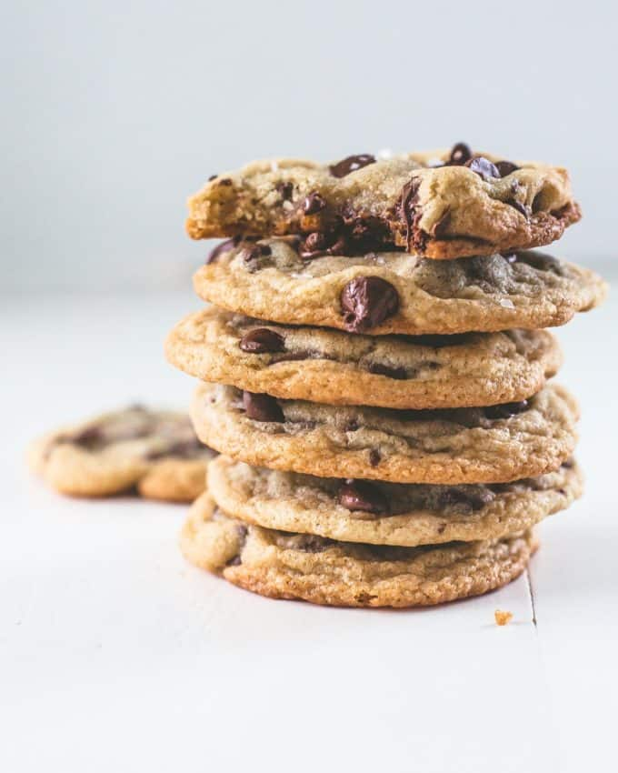 chocolate chip cookies stacked on a white table