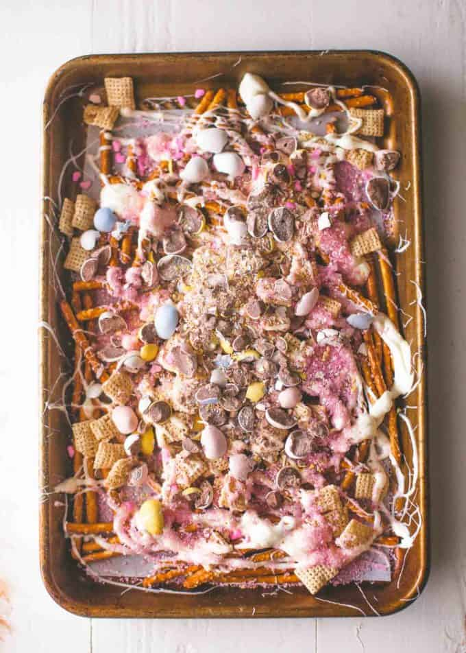 Easter Egg Crunch Bark on a sheet pan lined with parchment paper