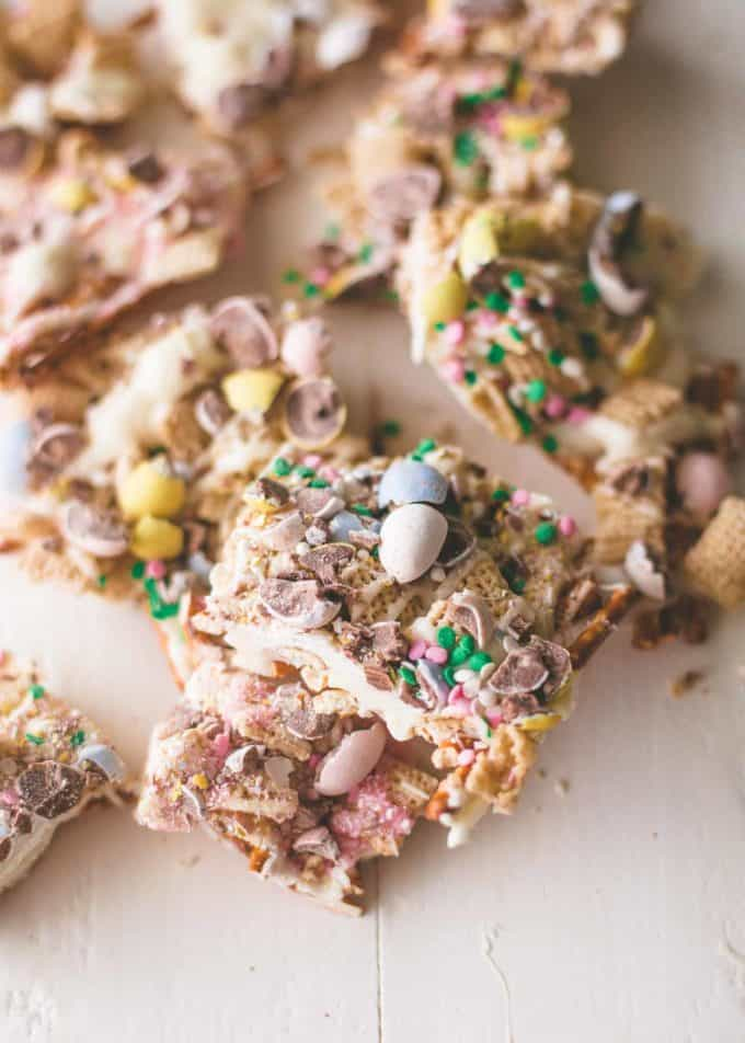 Easter Egg Crunch Bark broken into large pieces on a white table