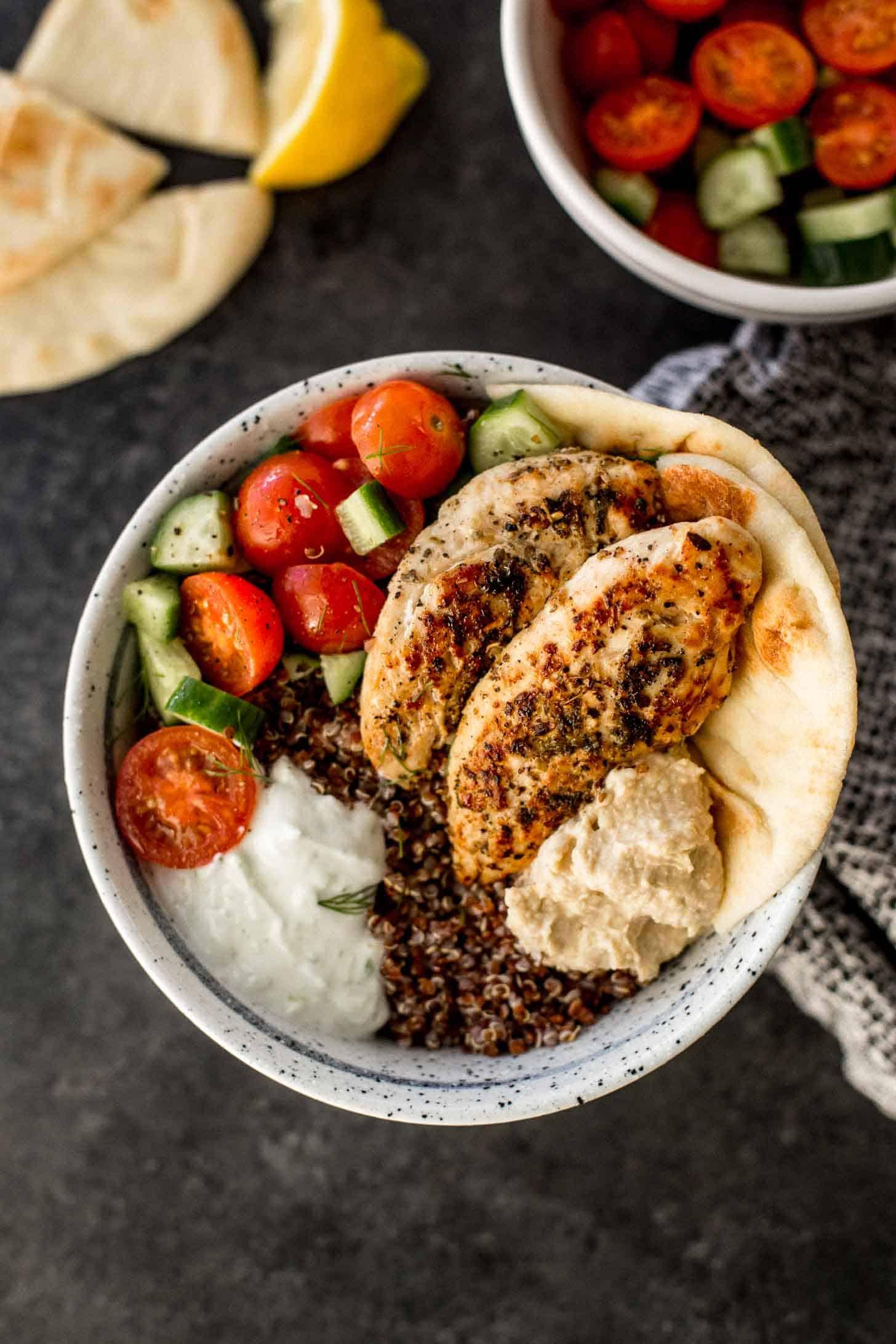 mediterranean chicken quinoa bowl on a grey countertop