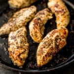 chicken tenderloins in a cast iron skillet
