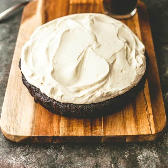a round One-Bowl Chocolate Guinness Cake on a wooden tray