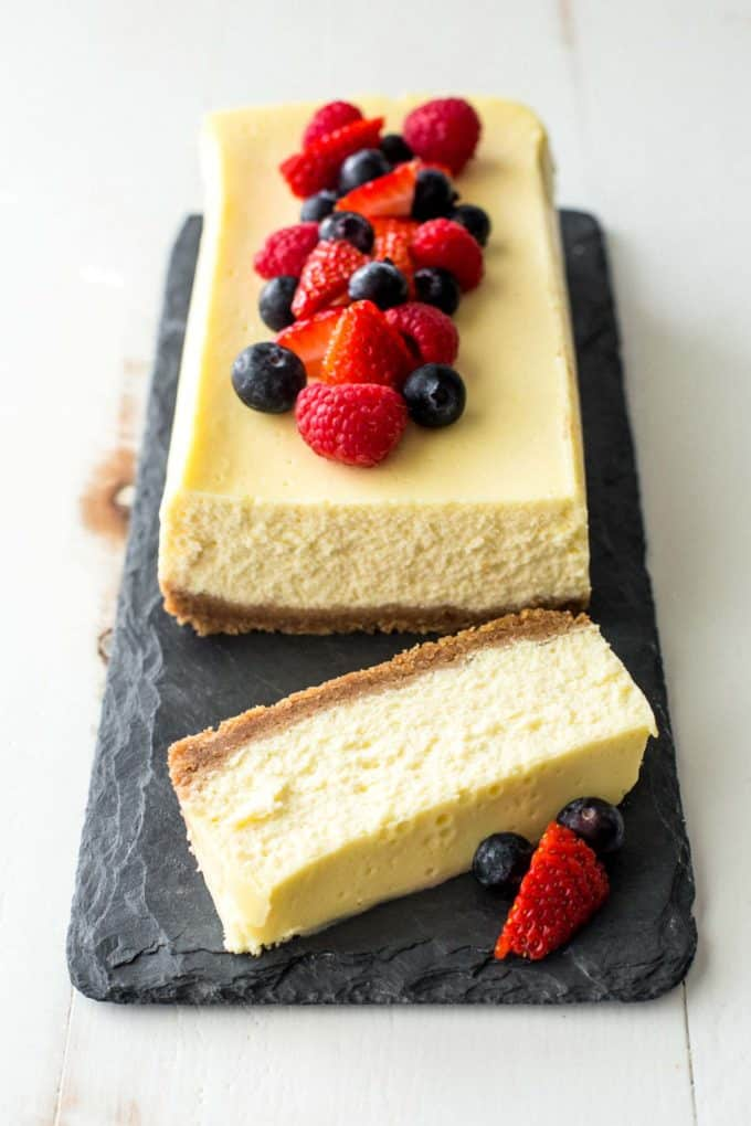 slow cooker classic cheesecake on a grey slate