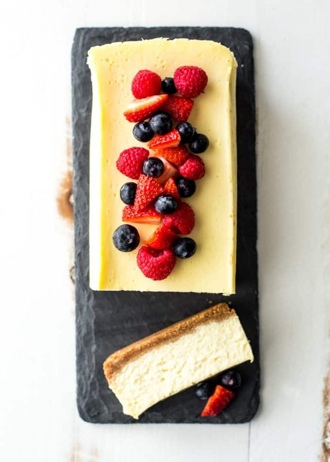 slow cooker classic cheesecake on a slate board