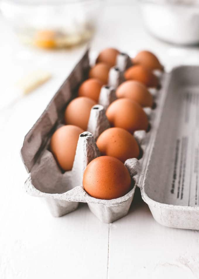 eggs in an egg crate on a white table