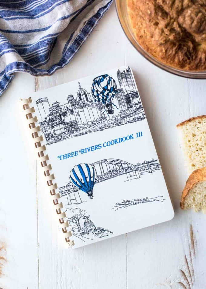 a white spiral bound cookbook on a white table