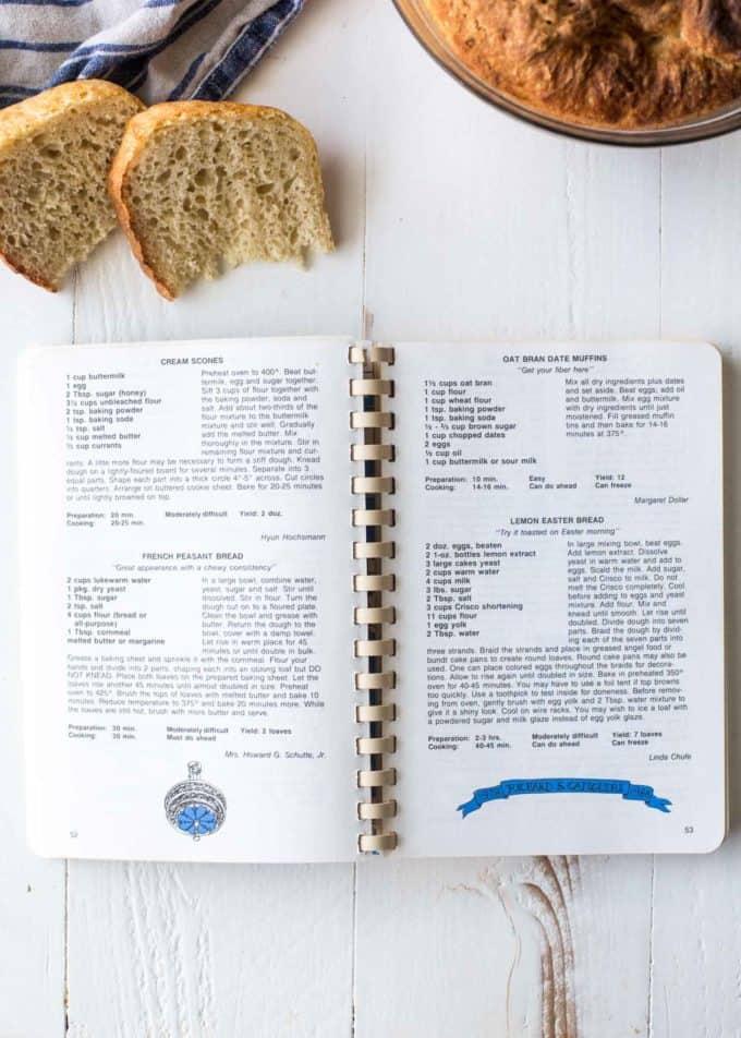 a spiral bound cookbook open to a Bread recipe