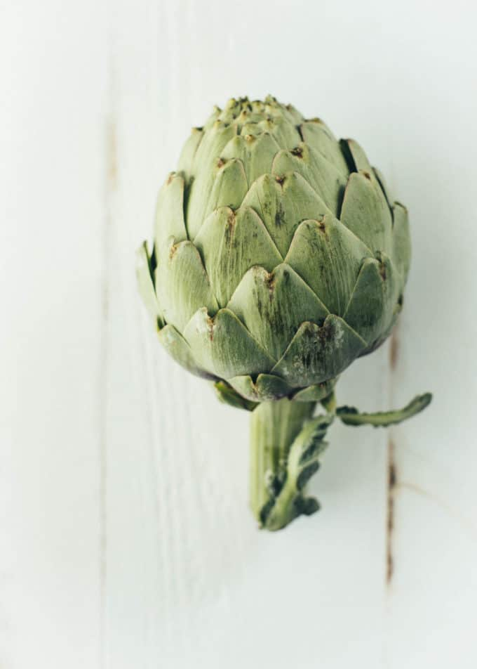 artichoke lying on a white table