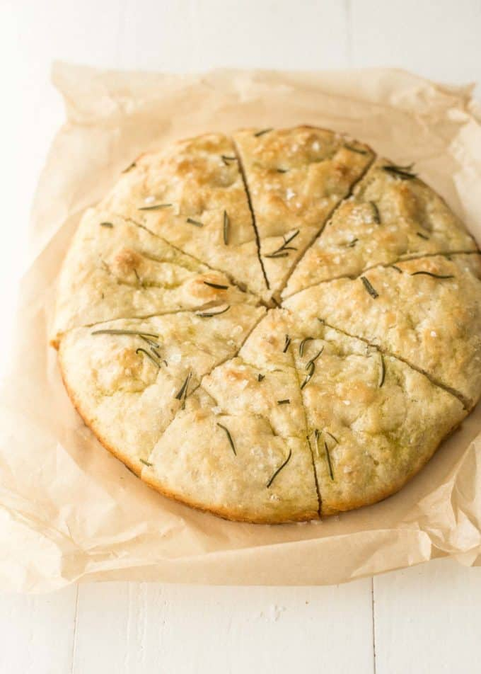 sliced no knead focaccia on parchment paper