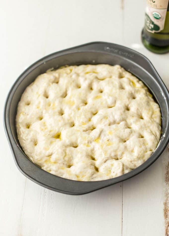 no knead focaccia dough in a round pan