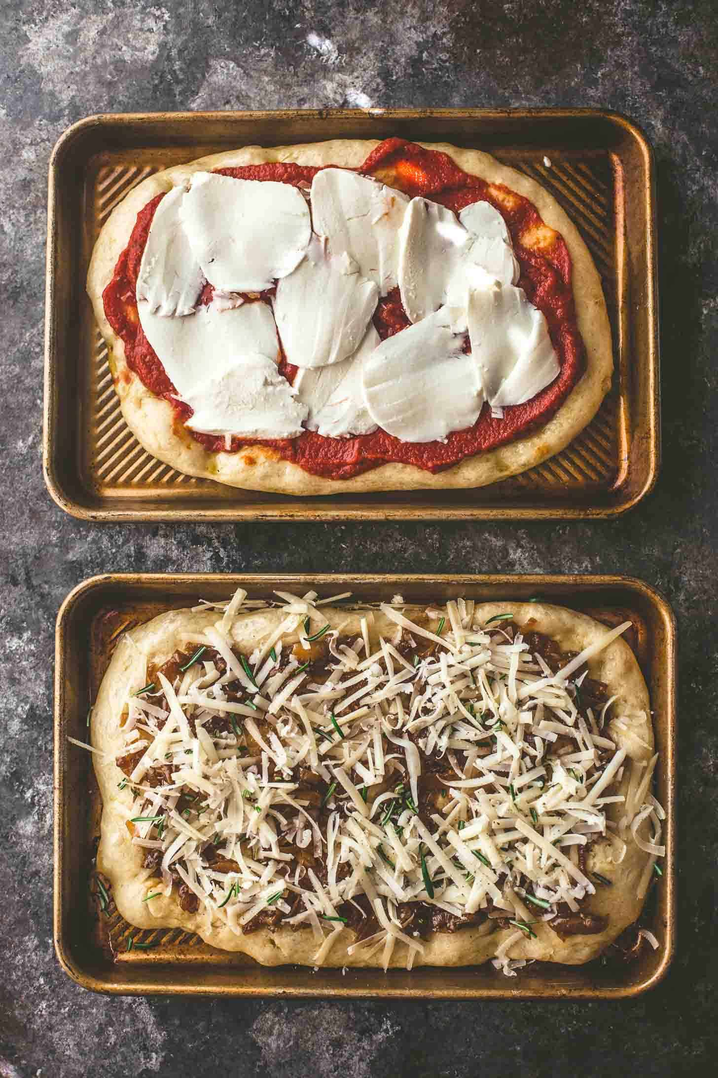 2 no knead pizzas before baking on sheet pans