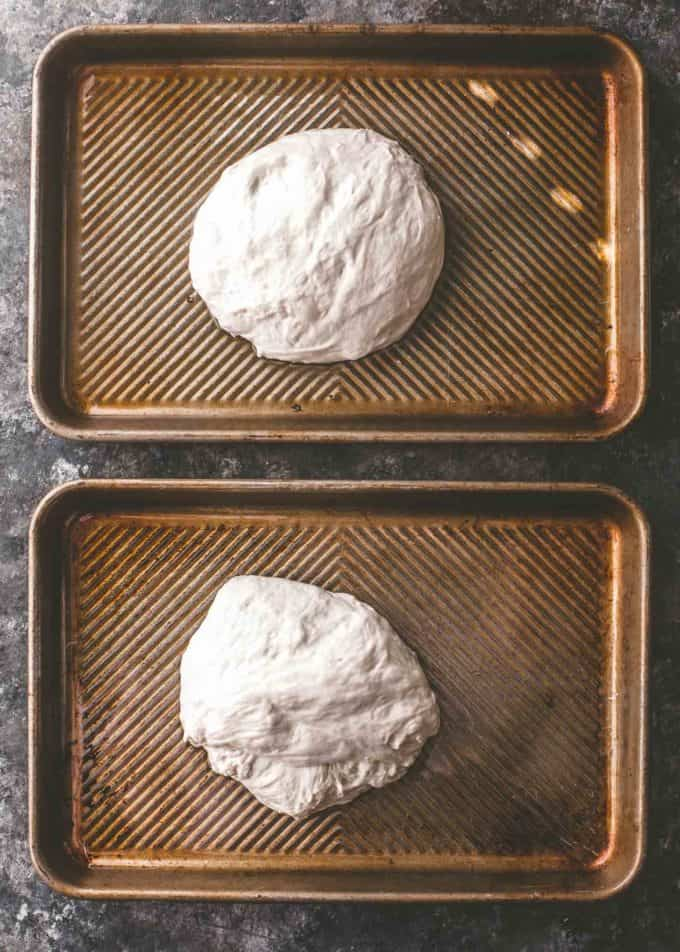pizza dough on oiled sheet pans