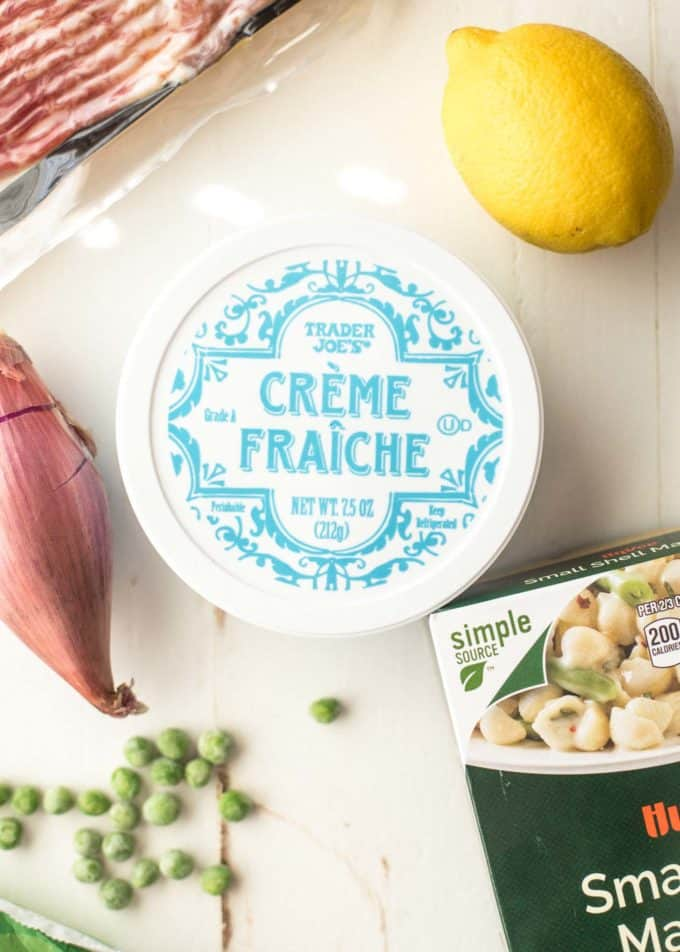 creme fraiche on a table with a lemon and shallot