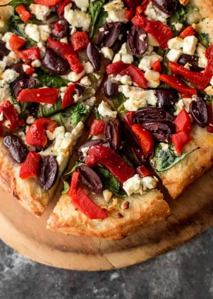 Greek Pizza close up, sliced