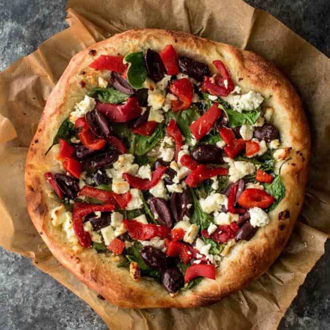 Greek Pizza on parchment paper